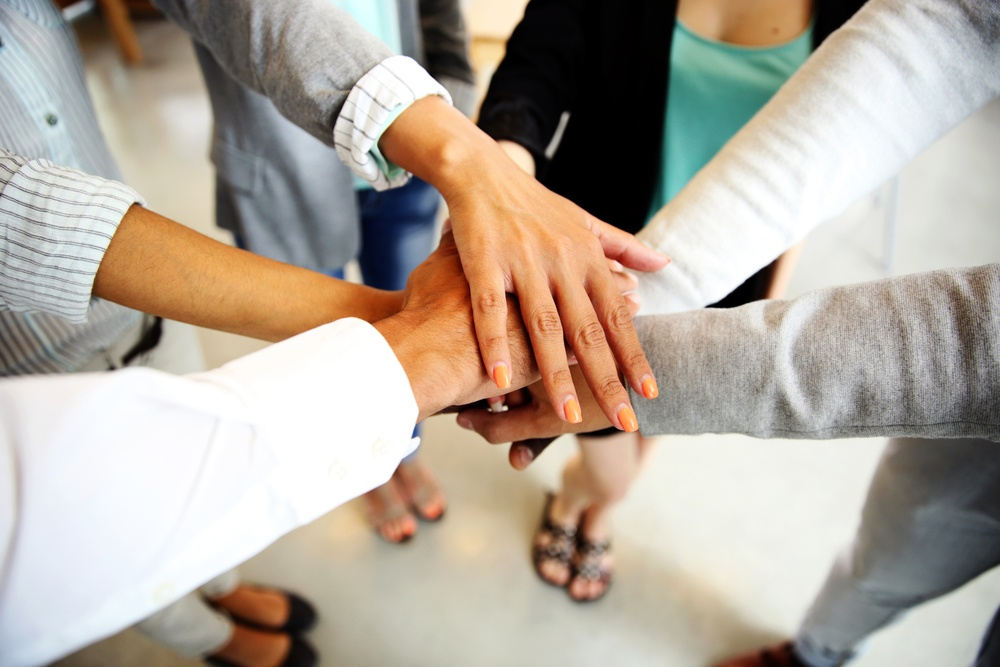 Business people joining hands-2