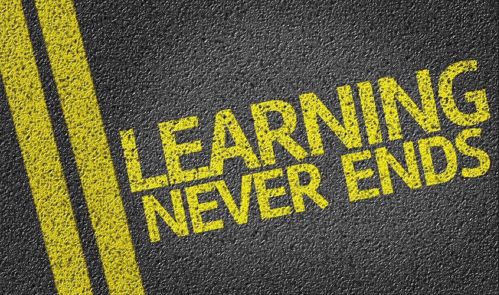 Learning Never Ends written on the road